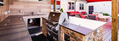Exterior view of the rooftop lounge at AMLI Interlocken apartments with up close view of the stainless steel barbecue grill