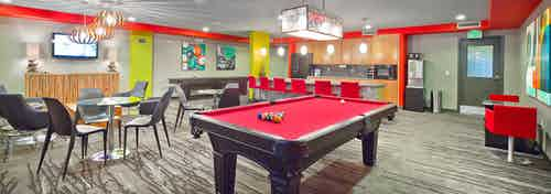 Interior of the Java Cafe at AMLI 535 with seating kitchen pool table and coffee machine
