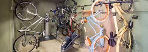 AMLI at Mueller bike repair room with bikes hanging vertically on the walls and a pump for filling wheels in the background