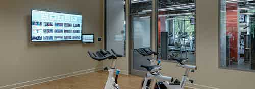 The yoga and spin room at AMLI 900 which has open free space in addition to a few specialized machines and a flat screen TV