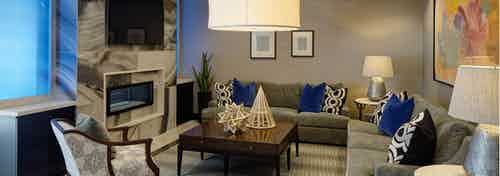 Resident lounge at AMLI Deerfield with a marble fireplace and large TV with various couch and chair seating options