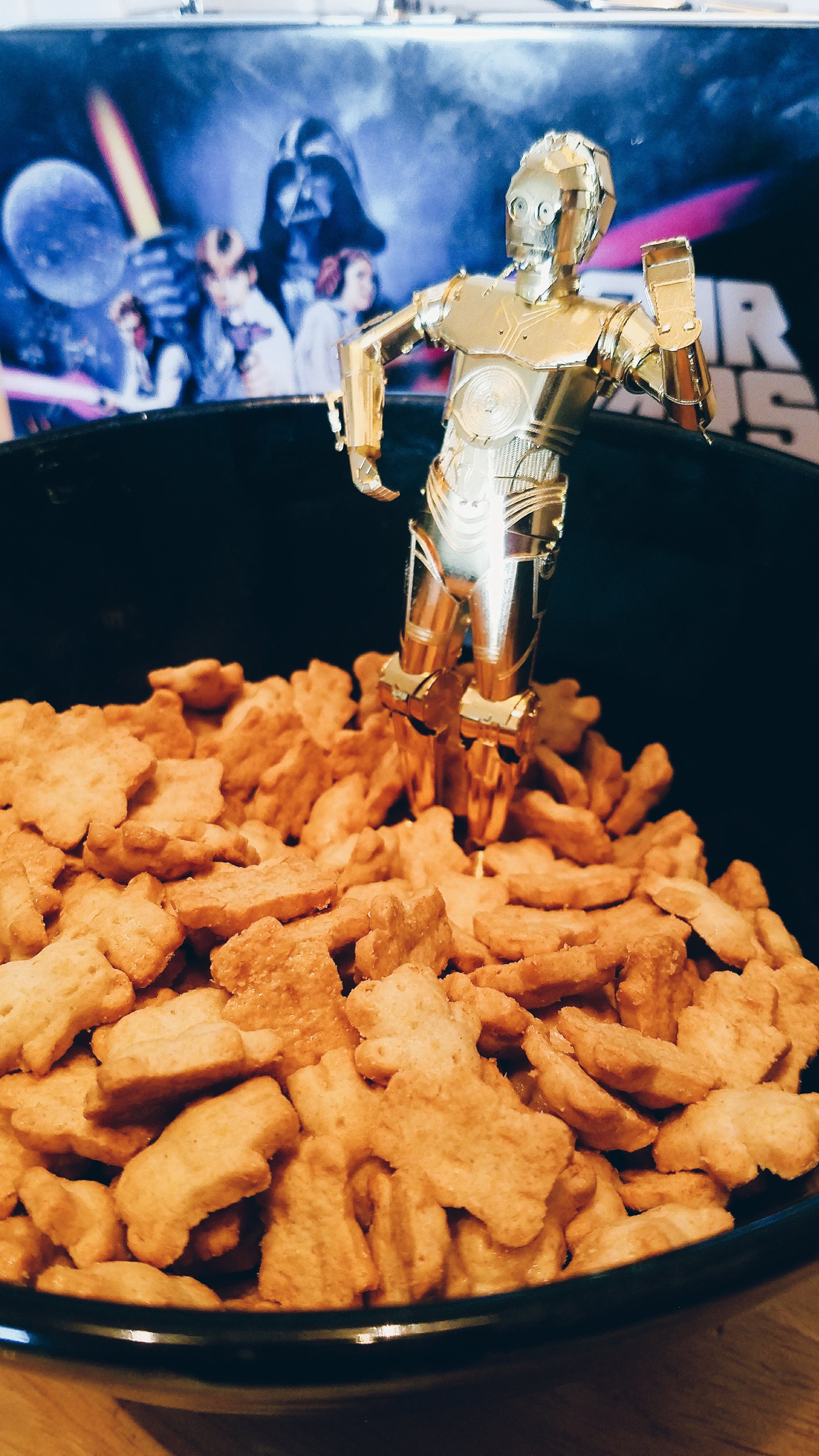Metal model of C-3PO in a bowl of teddy graham crackers so it looks like 3PO and ewoks