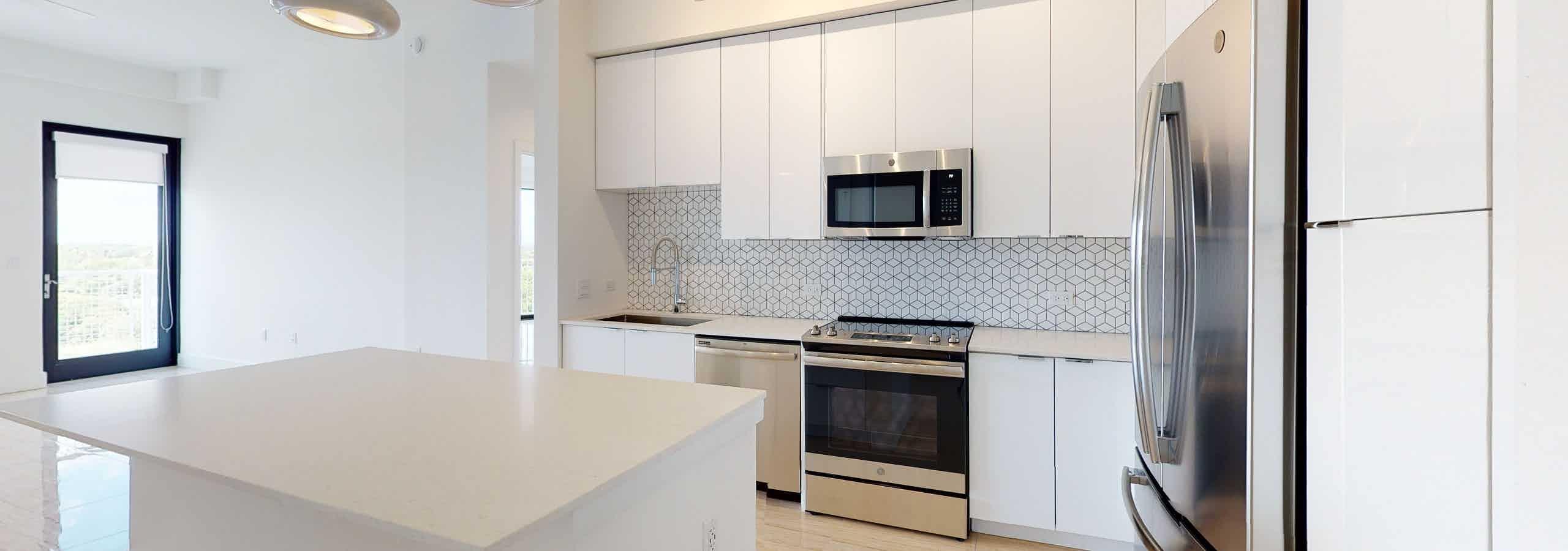 Island kitchen with designer tile backspash
