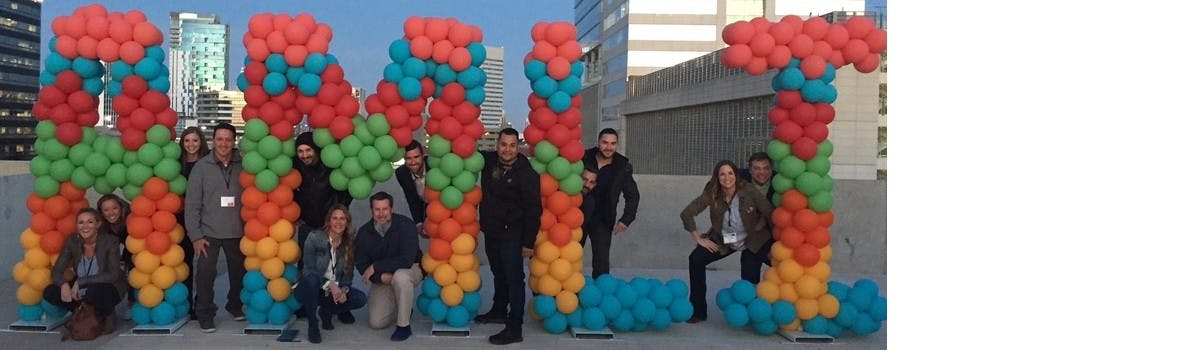 AMLI Team Posing With Balloons