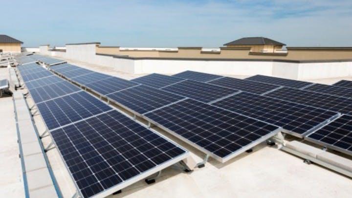 Daytime exterior view of solar panels on an AMLI apartment building roof denoting AMLI's sustainability focus