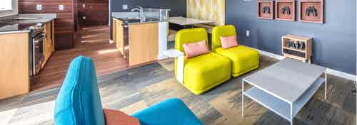 Take in the views of downtown Seattle from our rooftop lounge at AMLI Wallingford with a fully equipped kitchen colorful seating area