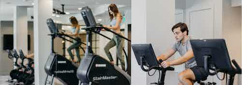 Close up of AMLI Addison resident using a Peloton bike and two residents using stair climbing machines in the fitness center