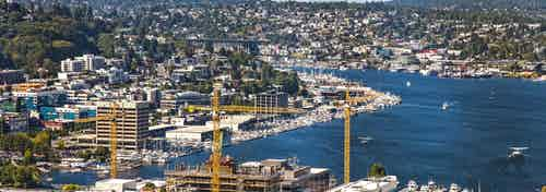 Blue Sky sunny Seattle Day Exterior view from AMLI Arc of Lake Union Wallingford and Westlake Ave from the 41st floor