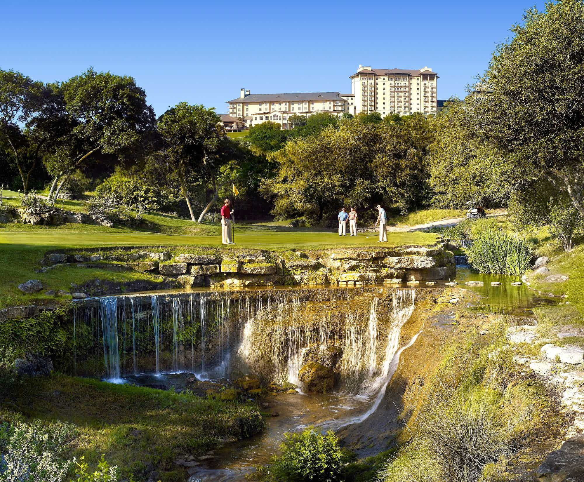 scenic golf course with waterfall