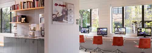AMLI Covered Bridge resident cyber zone and business center with computers and red swivel chairs