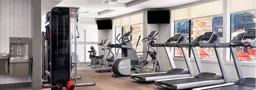 AMLI Covered Bridge 24-hour state-of-the-art fitness zone with treadmills, elliptical machines, water station and weight machines