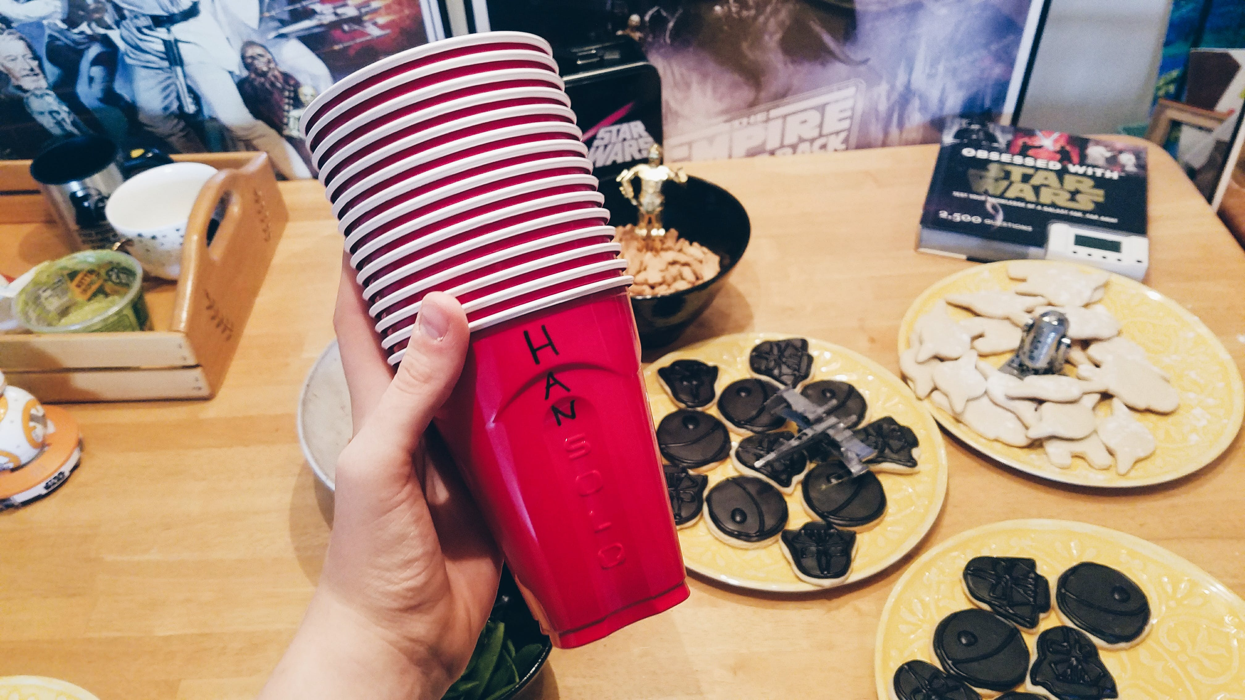 A stack of red solo cups with the word han written in sharpie before the word solo.