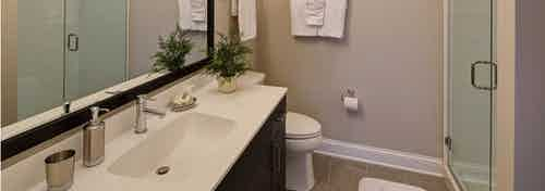 AMLI Deerfield apartment community bathroom with a single vanity and ample counterspace and stand up shower with glass door