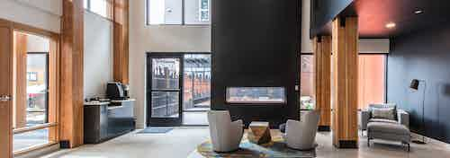 Interior resident area at AMLI Wallingford with coffee maker fireplace and comfortable seating with access to courtyard