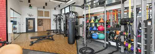 Close up view of equipment at AMLI Lenox fitness center with multiple exercise machines and brightly colored balls