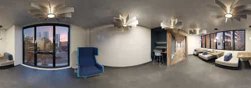 Panoramic rendering of AMLI Midtown Miami apartments The Collaborative co-working area with computer station and booth seating