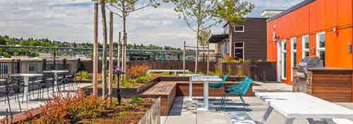 One of three rooftop decks at AMLI Wallingford with BBQ grill and lots of colorful seating to enjoy the Downtown Seattle and Lake Union View