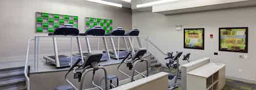 Alternate view of the fitness center at AMLI Evanston apartment community with treadmills and elliptical machines