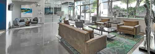 Interior of the AMLI 535 lobby with seating view into the leasing office and large entrance window and door