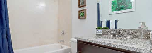 Interior view of AMLI Toscana Place townhome bathroom with vanity, toilet and soaking tub