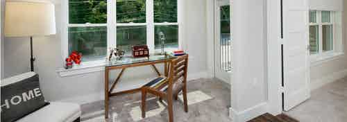 AMLI Piedmont Heights sunroom with carpet and large windows for natural light which is an extension of the living room