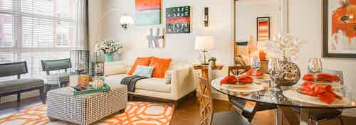 Interior view of a living room and dining room at AMLI Interlocken apartments with colorful dining room table set featured