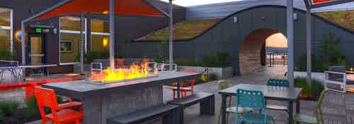 AMLI South Lake Union rooftop deck with fire pit plenty of patio seating and green roof