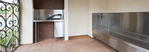 Interior daytime view of paw wash at AMLI Spanish Hills apartment building with stainless tub, grooming counter and dryer