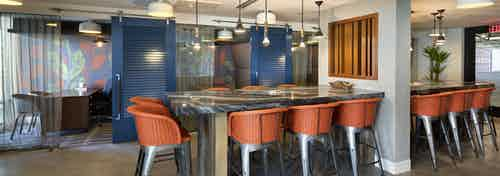 Interior view of AMLI Marina Del Rey apartment Dockwork co-working area with private offices and blue sliding barn doors