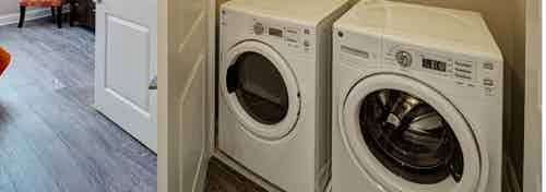 Closeup of full size side by side front loading washer and dryer appliance inside of a closet at AMLI Deerfield