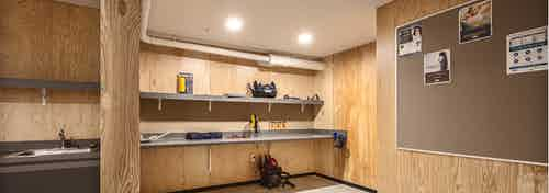 Interior of the DIY work room at AMLI Wallingford with ample work space tools bulletin board and a place to be creative