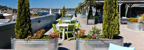 Rooftop view of AMLI 535 with patio seating and view of South Lake Union