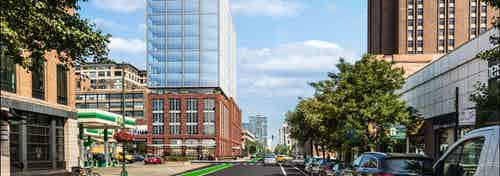 Rendering of AMLI 808 apartment building with red brick on bottom and glass on top and cars and trees lining the street