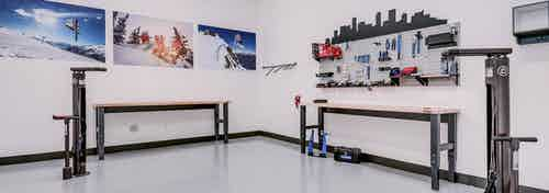 Interior bike repair room area at AMLI Cherry Creek apartments with view of work station table with tools and photography