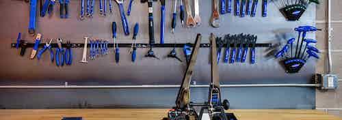 Bike/ski/snowboard repair room with magnetic tool bar holding an assortment of tools at AMLI Littleton Village apartments