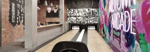 Rendering of the Arcade bowling alley at AMLI Midtown Miami apartments with colorful wall at right and seating at left