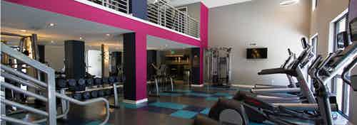 Two Story Fitness Center at AMLI Dadeland equipped with treadmills and high endurance