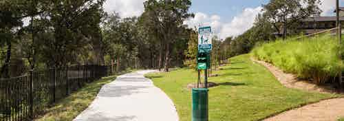 AMLI Covered Bridge's hiking trail that surrounds the community and provides pet waste eliminator stations