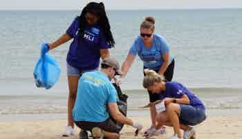 FAMLI volunteers pick up trash at beach