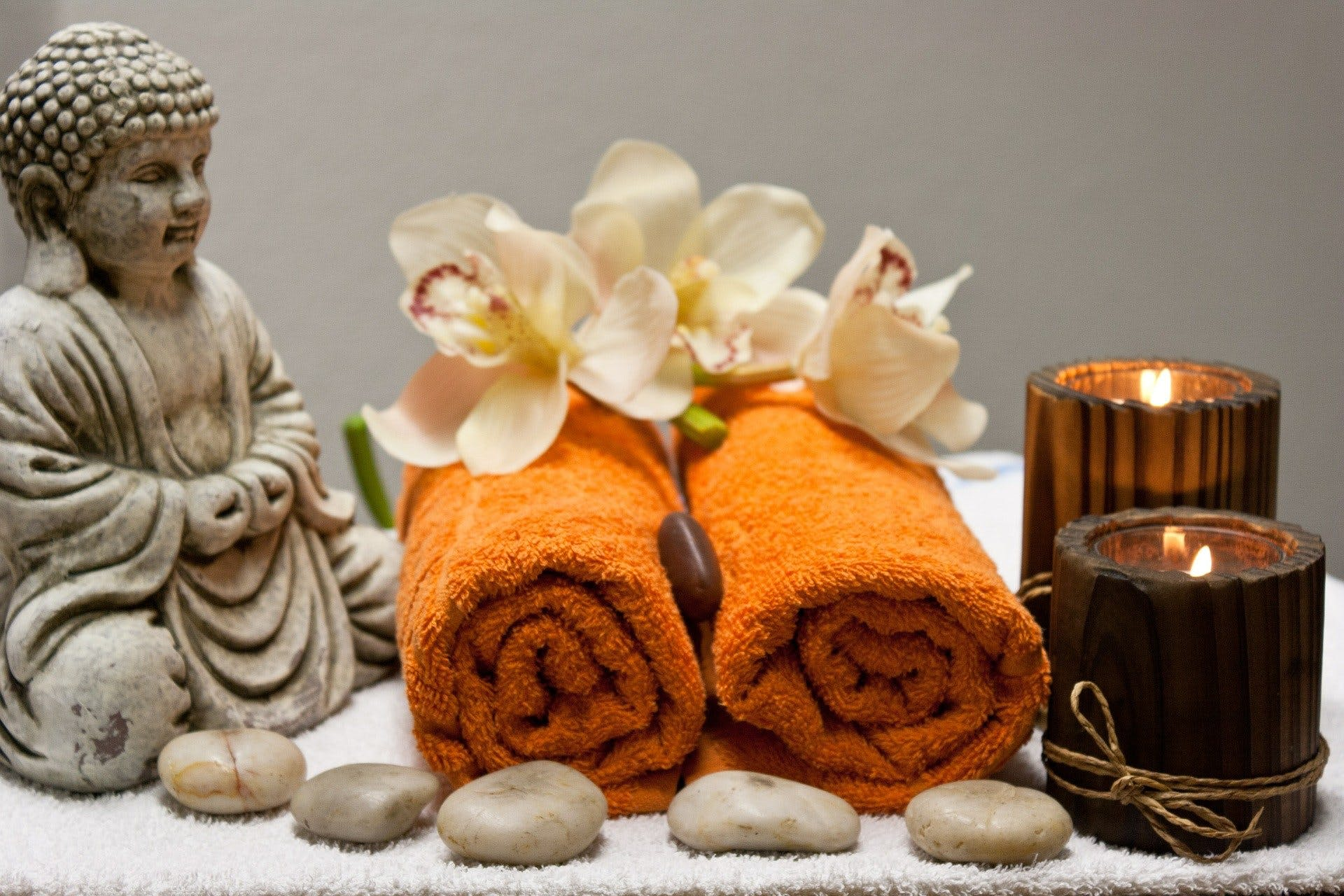 Spa day treatment with towels and candles