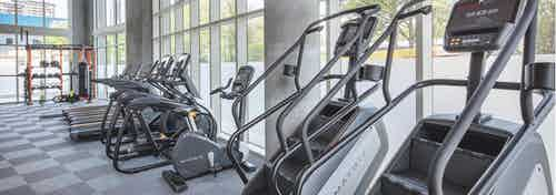 Close up of exercise machines at AMLI Arts Center fitness center including stair climbers, elliptical machines and treadmills