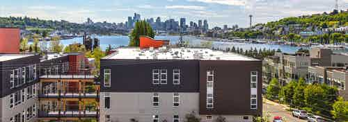 An exterior view of lake union and downtown Seattle from one of 3 rooftop decks at AMLI Wallingford on a beautiful sunny day