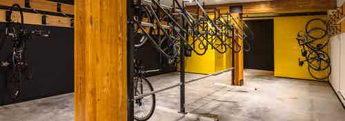 Second bike room at AMLI Wallingford with bike storage tools and yellow and dark blue colorful walls