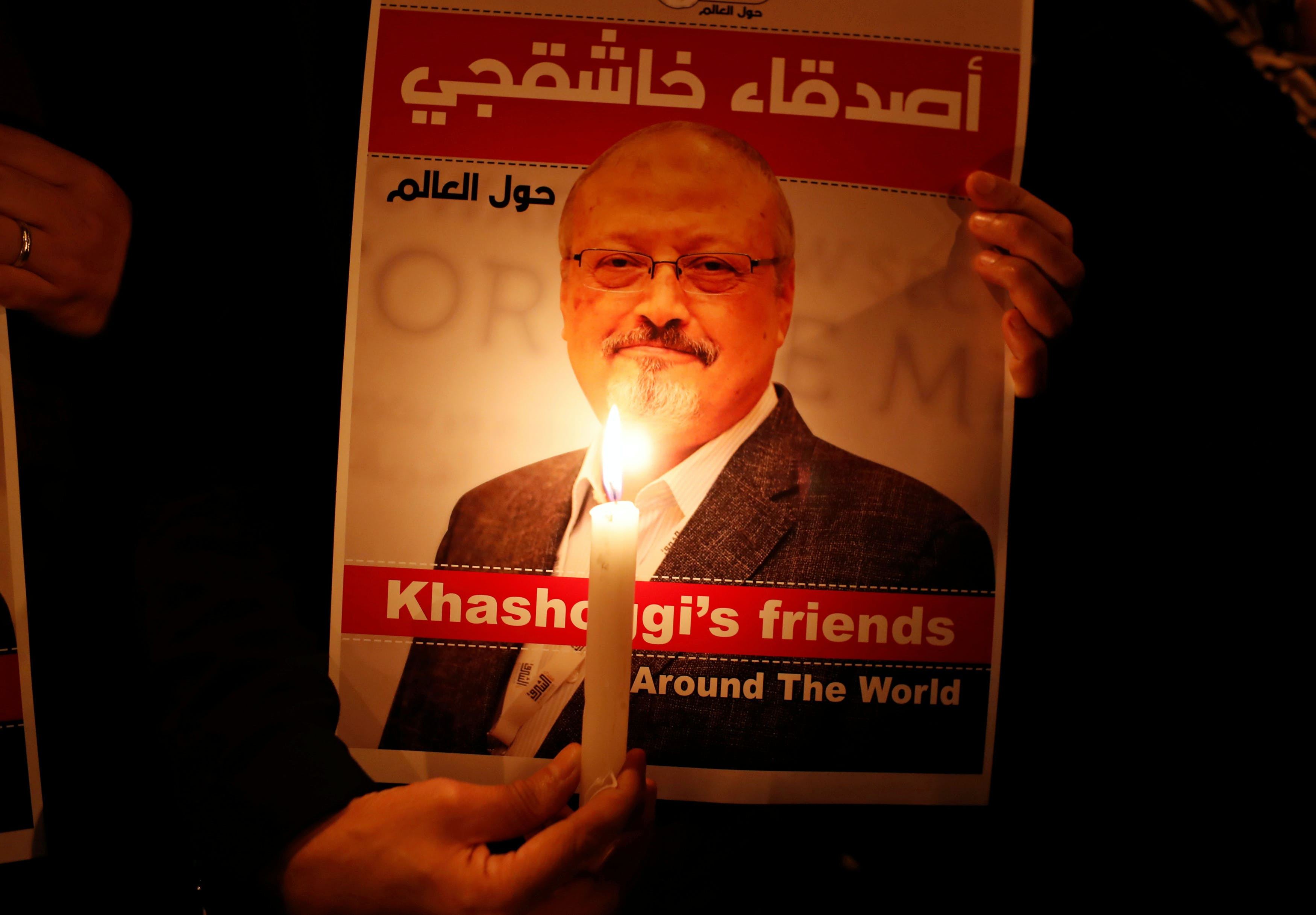 A demonstrator holds a poster with a picture of Saudi journalist Jamal Khashoggi outside the Saudi Arabia consulate in Istanbul