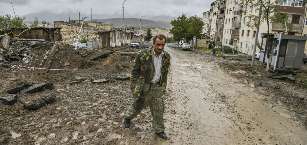 A man walks in the breakaway Nagorno-Karabakh region's main city of Stepanakert on October 6, 2020, during the ongoing fighting between Armenia and Azerbaijan over the disputed region.