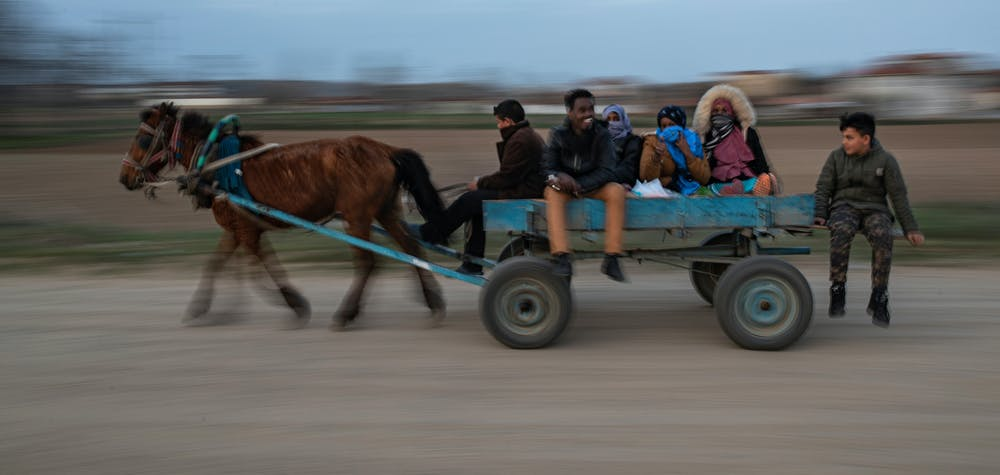 Migrants are transported by locals on a horse cart towards Turkey's Pazarkule border crossing with Greece's Kastanies, near Edirne, Turkey, March 8, 2020. REUTERS/Marko Djurica