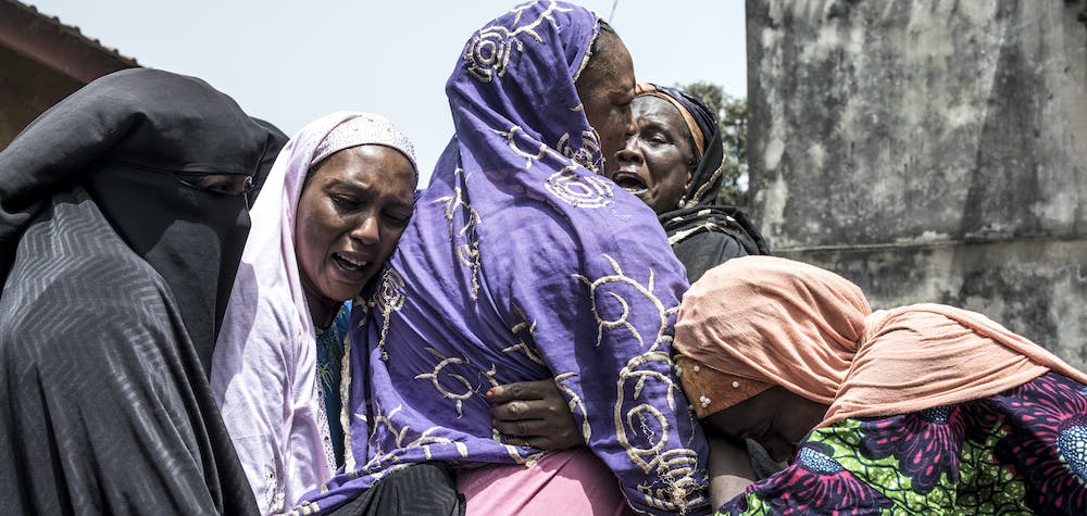 Family and community members mourn the death of Kudidiabou Bah in Conakry on March 01, 2020. - Kudidiabou, who was pregnant, allegedly succumbed internal bleeding caused after an altercation with security forces during a protest on February 29, 2020. Guinea's opposition on February 29, 2020 called for the cancellation of a referendum on changing the constitution, as fresh protests against President Alpha Conde's government broke out in the capital Conakry. The referendum will decide whether to adopt a new constitution, which includes bans on female circumcision and underage marriage in the West African country. (Photo by JOHN WESSELS / AFP)