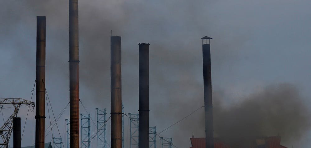 Smoke rises from the chimney of a paper factory outside Hanoi, Vietnam May 21,