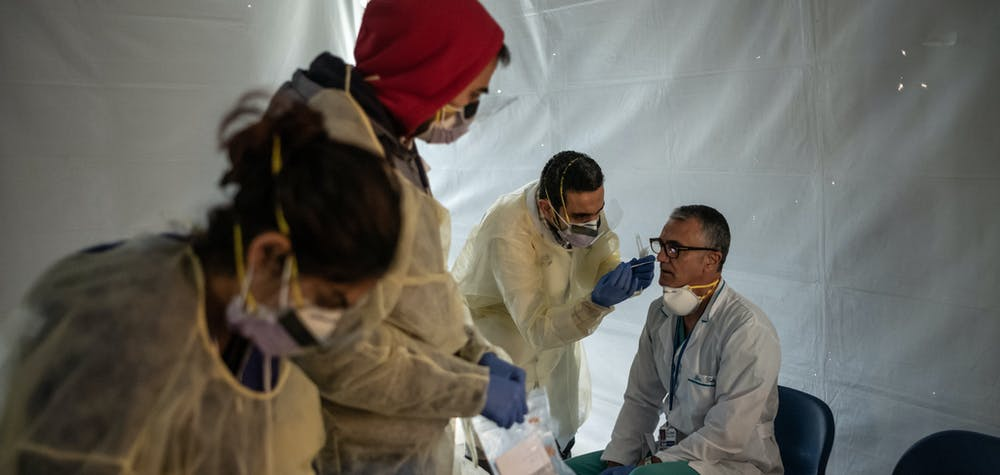NEW YORK, NY - MARCH 24: Doctors test hospital staff with flu-like symptoms for coronavirus (COVID-19) in set-up tents to triage possible COVID-19 patients outside before they enter the main Emergency department area at St. Barnabas hospital in the Bronx on March 24, 2020 in New York City. New York City has about a third of the nation's confirmed coronavirus cases, making it the center of the outbreak in the United States.