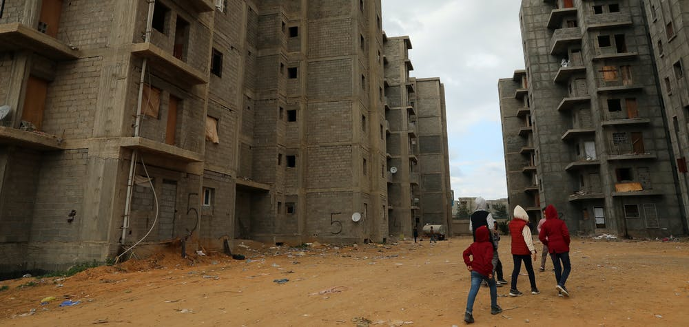 Displaced children walk between unfinished buildings in Tripoli, Libya January 16, 2020. REUTERS/Ismail Zitouny